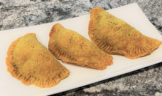 Vegetarian Jamaican Patties arranged on a plate